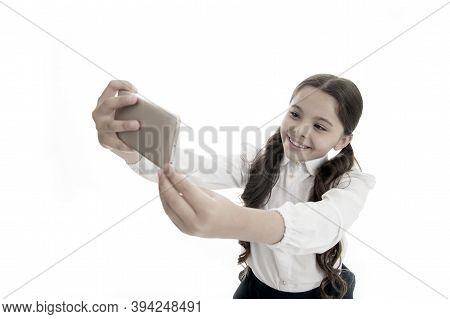 Selfie Mania. Perfect Selfie. Little Girl Makes Selfie On Smartphone. Selfie Mania And Weblog Of Lit