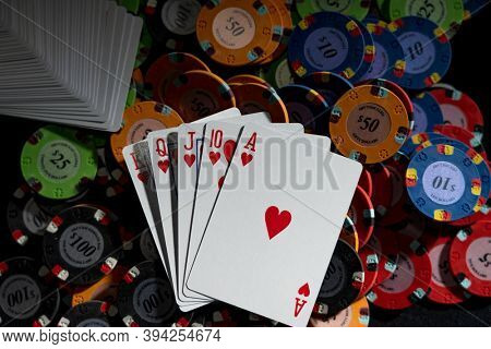 Poker game at the casino gambling table