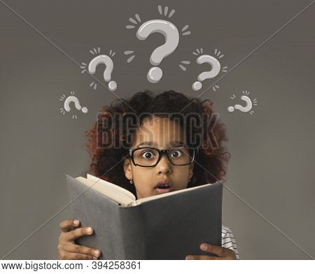 Puzzled Black Girl With Book Having Trouble Understanding School Program, Collage With Question Mark
