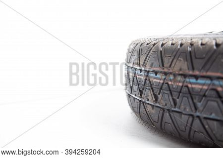 Close-up Of The Tread Of A Spare Tire Of A Car On A White Background In A Photo Studio With Summer T
