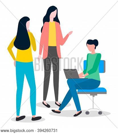 Group Of Young Women. Girl Sits In Office Chair On Castor, Works On Laptop. Female Boss Stands In Ja