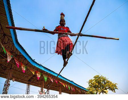 November 2019 Pushkar,rajasthan,india An Indian Girl Performs Street Acrobatics By Walking On The Ti