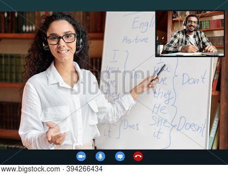 Online Tutoring. Portrait Of Woman In Glasses And Headset Having Video Conference, Teaching Foreign
