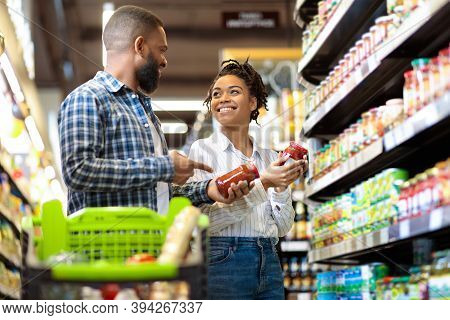 Black Family Couple Shopping Groceries In Supermarket Buying Food Walking With Trolley In Grocery Sh