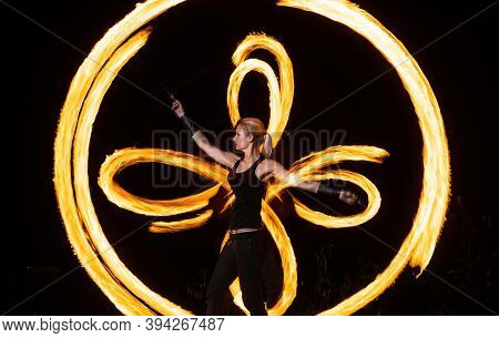 Kick Off The Holiday Season. Sexy Woman Perform Fire Tricks In Darkness. Fire Performance. Burning P