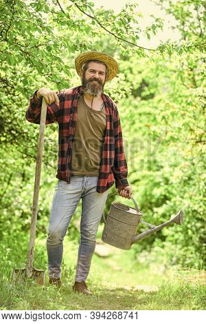 Look After Them And Store Them Carefully. Gardener Agricultural Worker With Garden Tools. Caucasian