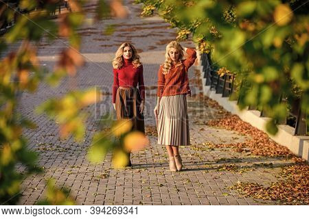 Fall Fashion. Adorable Ladies Enjoy Sunny Autumn Day. Fashionable Clothes. Femininity And Tenderness