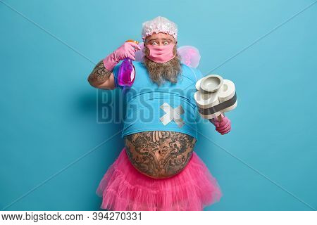 Surprised Funny Bearded Male Fairy Poses With Cleaning Product, Tidy Up Room, Cares About Purity And