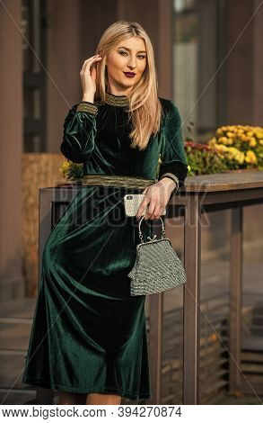 Young And Free. Elegant Woman In Green Velour Dress. Glamour Velvet Textile. Sexy Businesswoman Wait