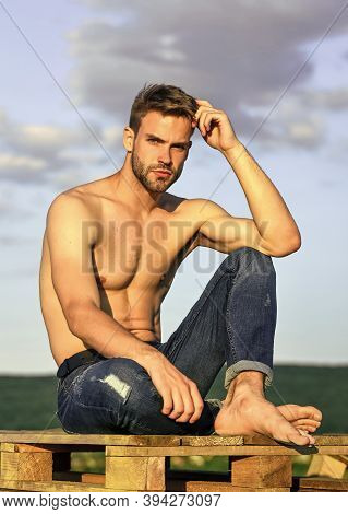 Fitness Model. Athletic Handsome Macho Wear Denim Pants. Muscular Body. Muscular Bare Torso. Six Pac