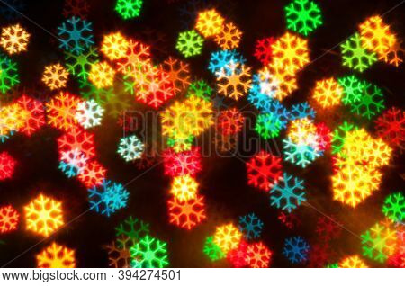 Christmas festive background, Christmas card. Blurred Christmas snowflake background, festive Christmas bokeh background, Christmas bokeh. Holiday Christmas glowing color lights, blurred Christmas bright abstract bokeh