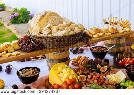 Party Table. Variety Or Assortment Of Cheese, Fruits And Deli. Close Up.