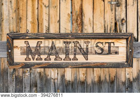 Old Weathered Vertical Pine Wood Plank Background With Main Street Sign