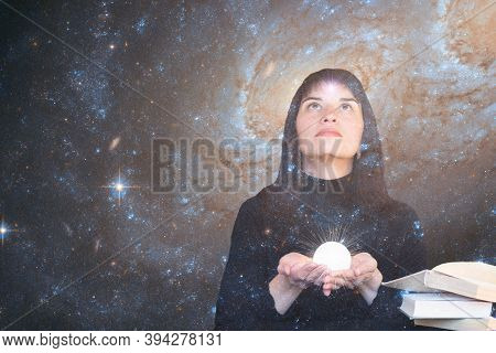 A Girl With A Star In Her Forehead Holds A Shining Ball In Her Hands And Looks Up At The Starry Sky.