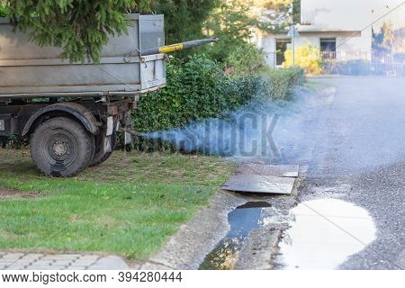 Toxic Smoke From Truck Exhaust Pipe. Truck Parked In The Countryside. Toxic Exhaust Polluting The En