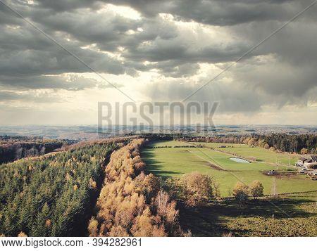Aerial Of Pine Forest And Meadow And Pasture In The Ardennes, Belgium. Beauty In Nature.