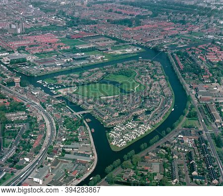 Leiden, Holland, May 17 - 1985: Historical aerial photo of the Waard eiland, a green and recreational residential island