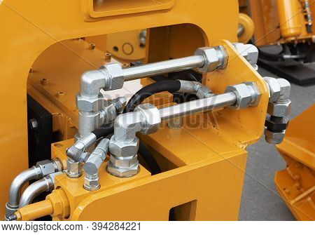 Hydraulic Pressure Pipes And Connection Fittings Of Industrial Equipment. Hydraulic System Of Tracto