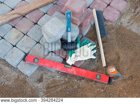 Equipment For Laying Paving Stones In Layers. Garden Brick Pathway Paving Process. Laying Concrete P