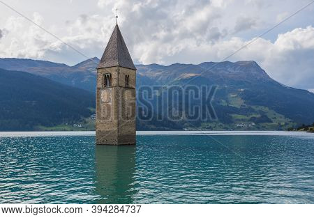 The Bell Tower Of The Sunken Church In Curon, Resia Lake, Bolzano Province, South Tyrol, Italy.