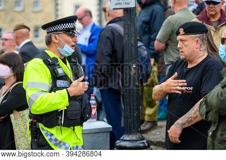 Richmond, North Yorkshire, Uk - June 14, 2020: Police Officer Wearing Face Mask Confronts British An