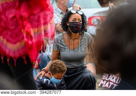 Richmond, North Yorkshire, Uk - June 14, 2020: Woman Wears Black Lives Matter Ppe Face Mask And Salu
