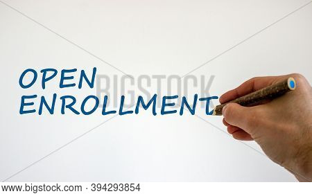 Hand Writing 'open Enrollment', Isolated On Beautiful White Background. Medical Concept. Copy Space.