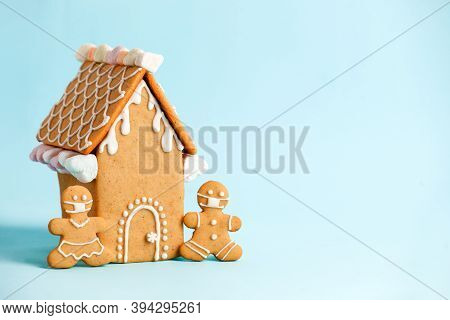 Happy New Year's Set Of House, Gingerbread Man In Face Mask From Ginger Biscuits Glazed Sugar Icing