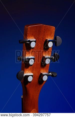 The Fretboard Of An Acoustic Guitar Closeup. Studio Photo Of A Musical Instrument. Mockup