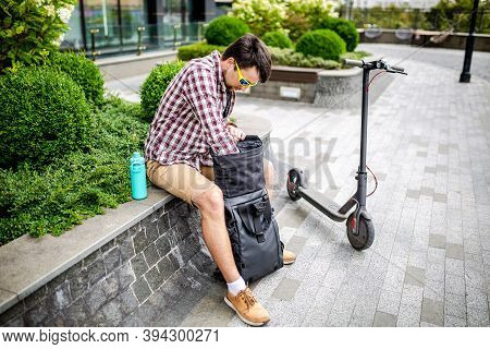 Subject Delivery By Electric Environmentally Friendly Transport. Deliveryman Arrived At Address And