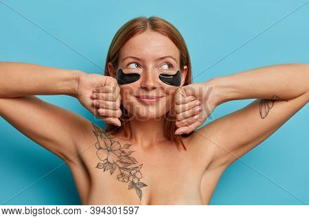 Pretty Redhead Adult Woman With Freckled Face, Applies Eye Patches, Shows Effect Of Perfect Skin, St