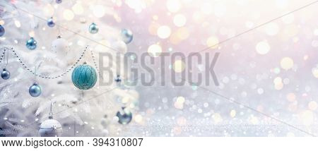 Winter Decoration With Christmas Tree And Bokeh Effect. Holiday Background With Shining And Lights