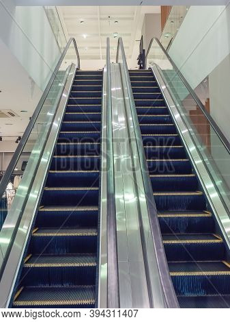 Empty Double Escalator With Silvery Shiny Handrail In Shopping Mall