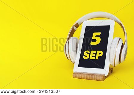 September 5th. Day 5 Of Month, Calendar Date. Stylish Headphones And Modern Tablet On Yellow Backgro