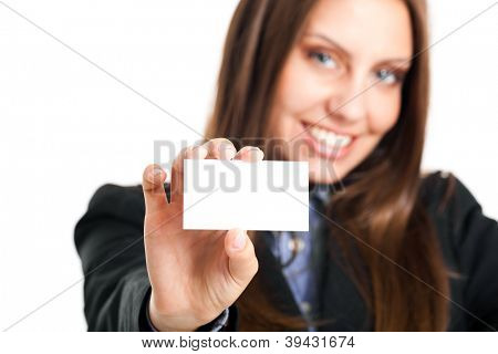 Beautiful young businesswoman showing an empty business card in which you can put your text