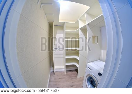 Installed New Built-in Furniture And Washing Machine In The Storage Room. Modern Dressing Room Close