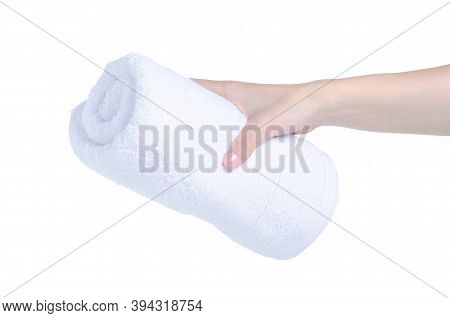 Rolled White Towel In Hand On White Background Isolation
