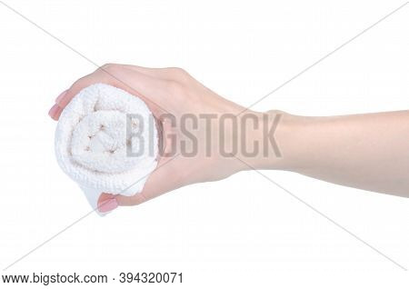 Rolled White Hand Towel In Hand On White Background Isolation