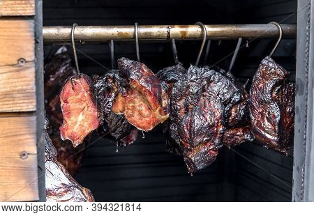 Smoking Meat In The Smokehouse. Traditional Method Of Smoking Meat In Smoke. Food Without Chemicals