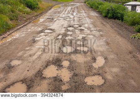 Potholes With Puddles On Icelandic Muddy Gravel Roads With A Lot Of Dirty Water