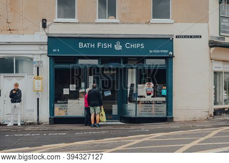 Bath, Uk - October 04, 2020: People Outside Closed Fish And Chips Shop In Bath, The Largest City In