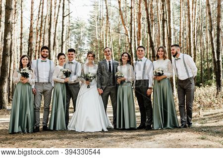 Newlyweds With Friends And Friendships,witnesses At The Wedding,wedding Day Of The Bride And Groom,c