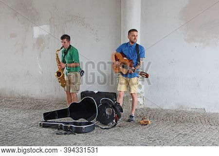 Gdansk / Poland. 21 June 2019:  Street Musicians Play Guitar And Saxophone. Musicians Play Outdoors