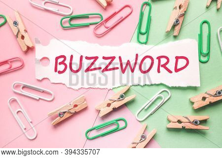Buzzword, Text On Paper On Colored Background