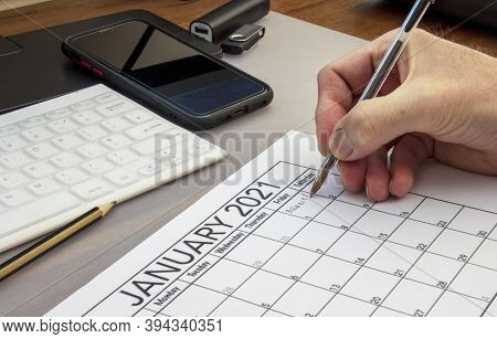 End Of The Brexit Transition Period Being Written Onto Calendar Page.