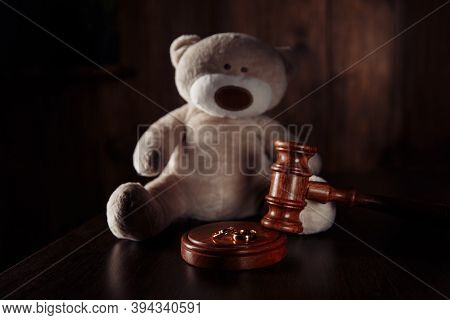 Divorce Concept. Wooden Gavel, Rings And Teddy Bear As Symbol Of Child. Family Divorce Effect On Chi