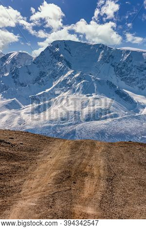 Portrait Size Landscape Of A Highland Road Leading To The Snowy Mountains Of The North Chuyskiy Moun
