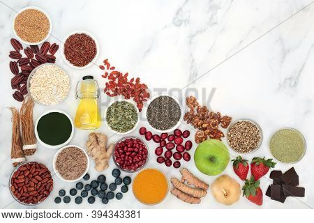 Super food  with herbal medicine for a healthy lifestyle with plant based health foods high in anthocyanins, antioxidants, lycopene, vitamins, minerals, smart carbs, dietary fibre, omega 3 & protein
