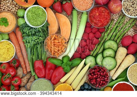 Immune boosting vegan food for good health with foods very high in antioxidants, ancthocyanins, protein, vitamins, minerals, smart carbs, protein & lycopene. Healthy & ethical eating concept.Flat lay.