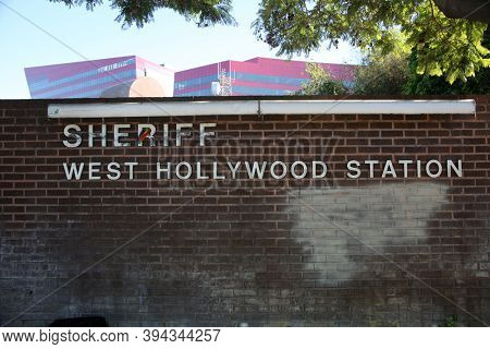 West Hollywood, California / USA - November 10, 2020: West Hollywood Sheriff Station sign on a brick wall. Editorial Use Only.